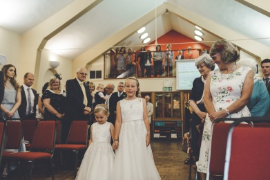 The two beautiful girls walking up the aisle. Their dresses are from Debenhams.