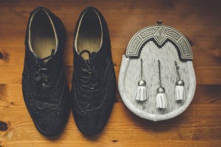 His shoes + sporran.